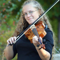 ARCS Scholar Rachel Gewiss playing the violin outside