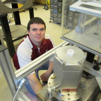 Ian Richardson assembling a cryostat in the lab.