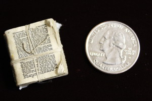 Philip Dasch Bible next to quarter