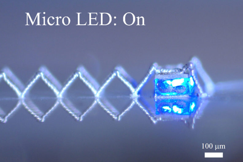 Manufactured 3-D electronic interconnects light an LED
