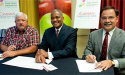 Jim Doornink, Elson Floyd, Dan Bernardo signing the gift and research agreement.