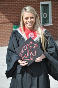 Dominique Mesick proudly shows off her spirited mortarboard hat at her 2011 WSU commencement celebration.