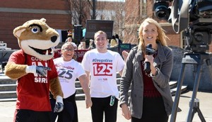 KREM-2 News' Melinda Lee reports from Terrell Mall during the inaugural #CougsGive day of giving last year. (Photo by Shelly Hanks, WSU Photo Services)
