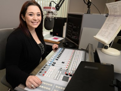 Janelle Mendoza ('14; '15) records programming announcements in the studio of Northwest Public Radio on the campus of Washington State University in Pullman.