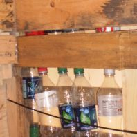 Plastic soft drink and water bottles provide privacy, allow daylight, and serve as protection from inclement weather.