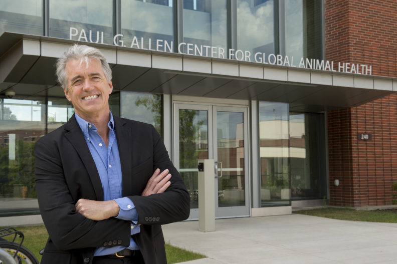 Guy Palmer standing in front of WSU's Paul G. Allen Center for Global Animal Health.