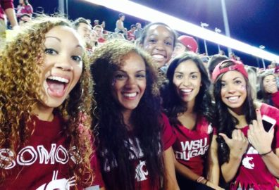 Kayla Davis (left) enjoys a Cougar Football game with her friends.