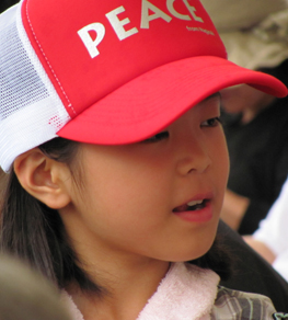 Child at Japanese memorial service